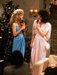 "Liz and Candy Sweeney  (Jan Hooks, left, and Nora Dunn) butcher some holiday standards at their annual Christmas party (c/o ""Saturday Night Live FAQ"")."